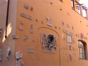 External studio wall with sculptures