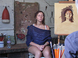 A painting demonstration with sitting girl